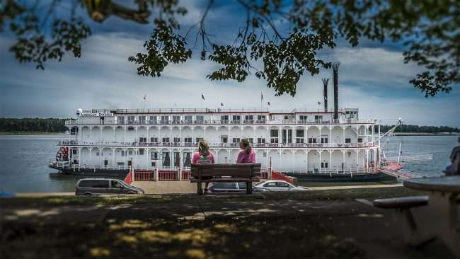 Aug 25, 2017 - Beautiful mother and daughter spending quality time together while sitting on bench looking out at the American Duchess riverboat that made its first voyage to the Port of Paducah/photonews247.com