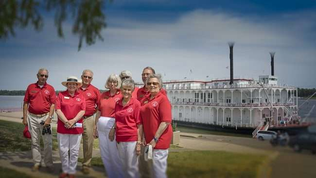 Aug 25, 2017 - Paducah Ambassadors volunteer their time helping and greeting visitors from the American Duchess riverboat (background) docked on the banks of the Ohio River in downtown Paducah, KY/photonews247.com
