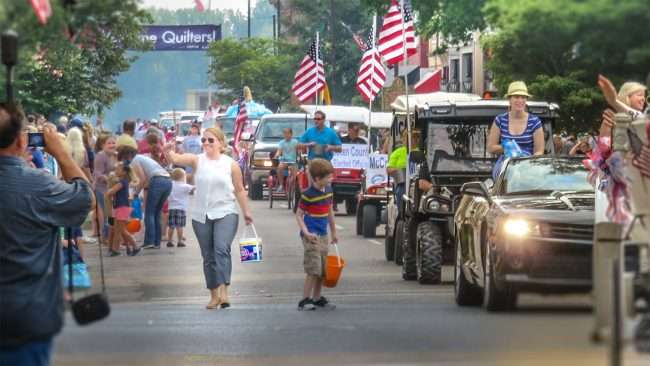 Sept 4, 2017 - Stunning Mayor Brandi Harless tosses candy to spectators while participating in Labor Day Parade on Broadway Main Street, Downtown Paducah, Ky/photonews247.com