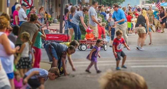 Sept 4, 2017 - Kids picking up candy during Labor Day Parade on Broadway Main Street, Downtown Paducah, KY/photonews247.com