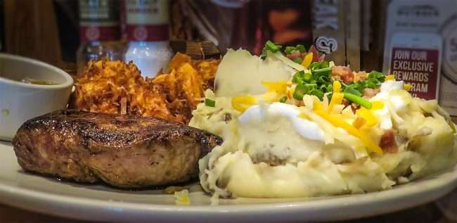Oct 4, 2017 - 6 oz Center Cut Sirloin, Loaded Mashed, Coconut Shrimp, at Outback Steakhouse restaurant in Paducah, KY/photonews247.com