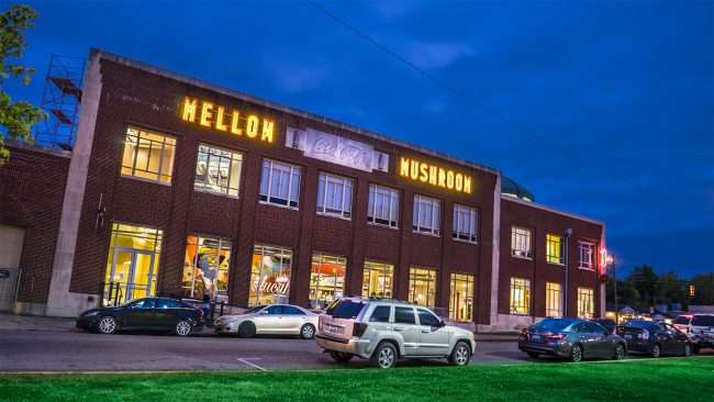 Oct 2, 2017 - Mellow Mushroom restaurant with big neon sign on historic Coca Cola Bottling Plant on Broadway Street, Paducah KY/photonews247.com