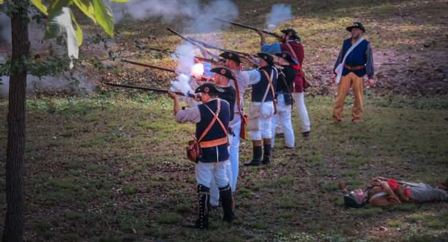 Oct 21, 2017 - Muskets fire flames in Mock Battle during 44th Annual Fort Massac Encampment 2017/photonews247.com