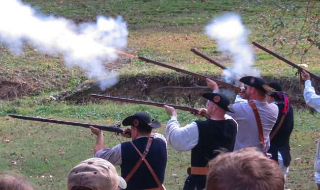 Oct 21, 2017 - Muskets fire with flames out of barrel in Mock Battle during 44th Annual Fort Massac Encampment 2017/photonews247.com