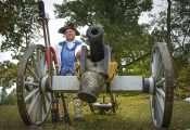 Oct 22, 2017 - Reenactor stands by cannon after mock battle during Fort Massac Encampment, Metropolis, IL/photonews247.com