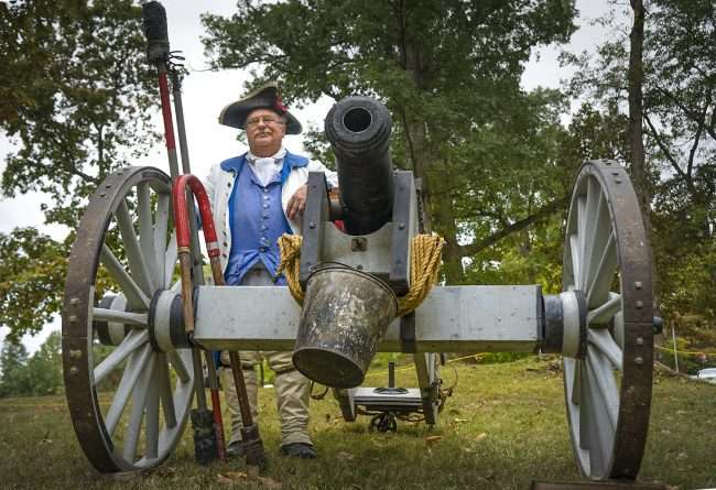 Oct 22, 2017 - Reenactor stands by cannon after mock battle during Fort Massac Encampment, Metropolis, IL/photonews247.com