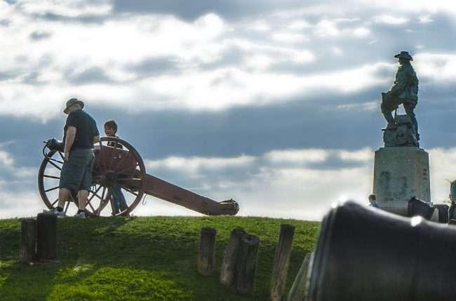 Oct 21, 2017 - Tourists view Cannon and statue of George Rogers Clark during Massac Park Encampment, Metropolis, IL/photonews247.com
