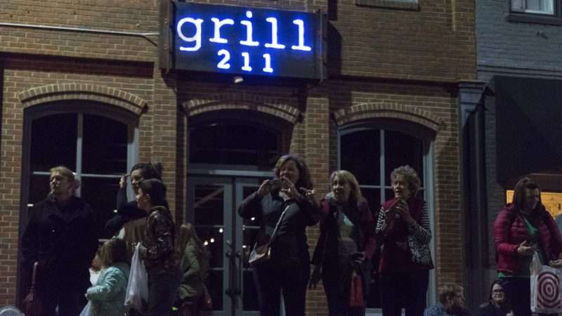 Dec 2, 2017 - Crowd in front of Grill 211 restaurant during Christmas Parade in Downtown Paducah/photonews247.com