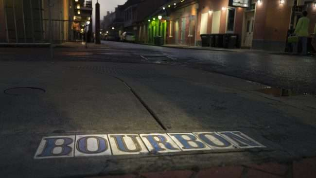 Dec 21, 2017 - Bourbon Street in tiles on sidewalk in the French Quarter neighborhood in New Orleans, LA/photonews247.com