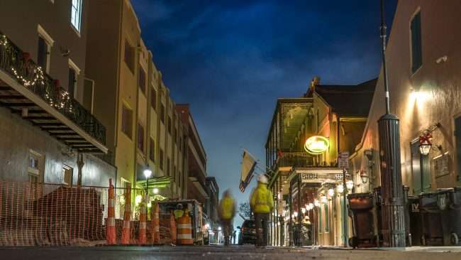 Dec 21, 2017 - Construction workers gather early on Bourbon Street, New Orleans, LA/photonews247.com