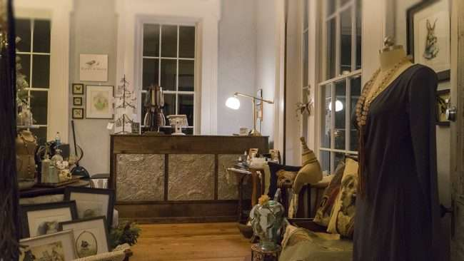 Dec 8, 2017 - Front desk at Raven and Moth with a view of pillows, clothes, art, jewelry in Lower Town Paducah, KY/photonews247.com