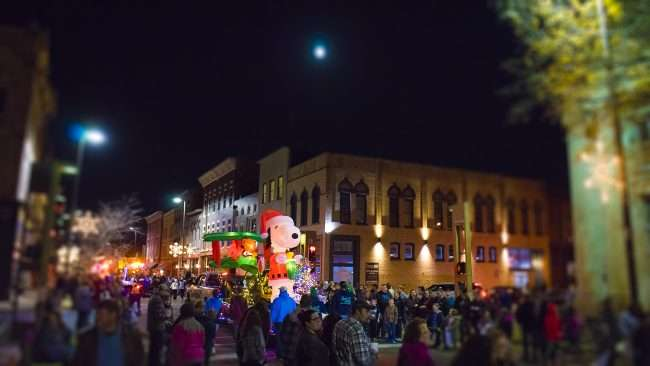 Dec 2, 2017 - Snoopy and Red Baron float by Citizens Gym and Reside Apartments during Christmas Parade Downtown Paducah/photonews247.com