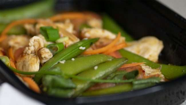 April 14, 2018 - Ginger Chicken includes stir fried chicken, sugar snap peas and more at Blue Ginger Asian Take Out Restaurant in Paducah, KY/photonews247.com