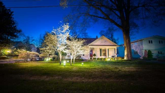 April 19, 2018 - Home along Lighted Paducah Dogwood Trail with lighted dogwood trees in front yard/photonews247.com