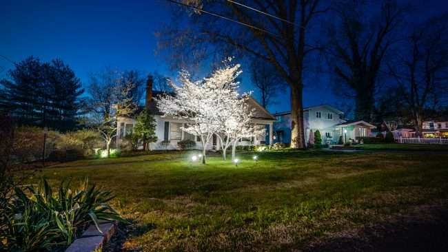 April 19, 2018 - Lighted DogWood Trail Paducah KY house with lighted plants and trees/photonews247.com