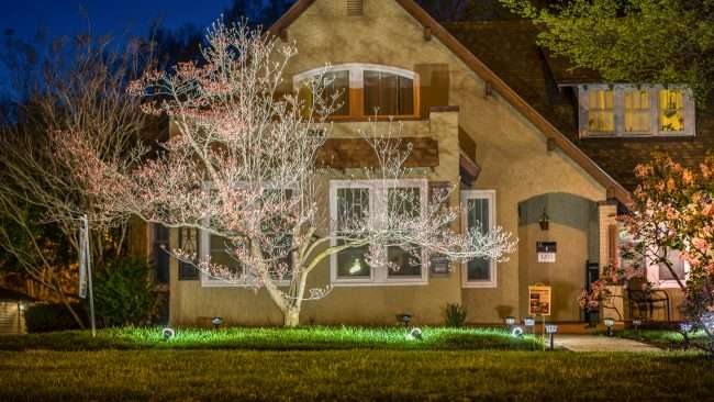 April 19, 2018: Lighted DogWood Trail Paducah - house on Broadway with floodlights on plants/photonews247.com