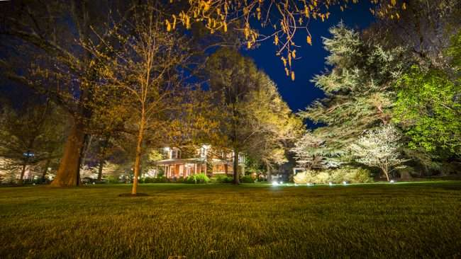 April 19, 2018 - Lighted DogWood Trail in Paducah with lighted home and lawn that look like a mansion from where I am standing/photonews247.com
