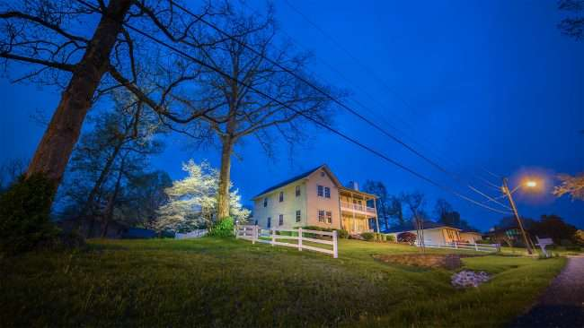 April 24, 2018 - Paducah's Lighted Dogwood Trail featuring big house on hill with dogwood tree lighted with floodlights/photonews247.com