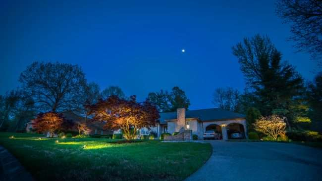 April 26, 2018 - Lighted Dogwood Trail Paducah showcases homes decorated with floodlights/photonews247.com