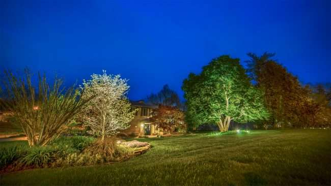 April 24, 2018 - Lighted Dogwood Trail Paducah with house decorated with floodlights/photonews247.com