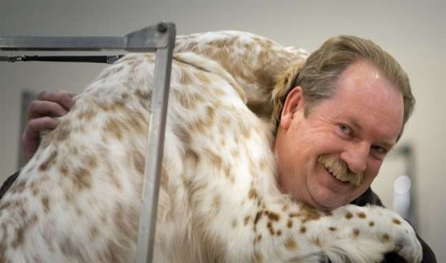 April 7, 2018 - Dog hugs owner at Paducah Dog Show at Paducah's Convention Center/photonews247.com