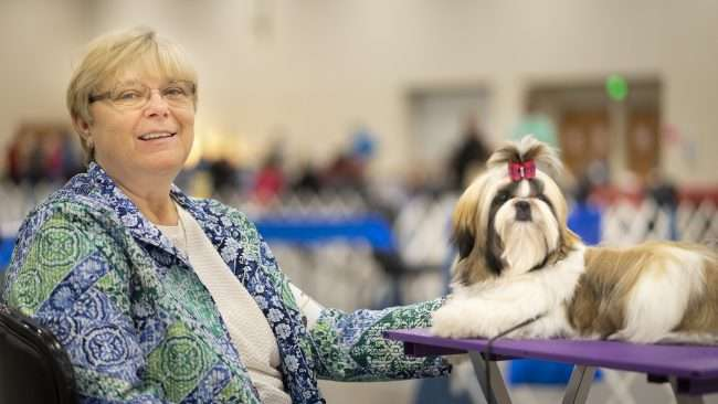 April 8, 2018 - Pet Fashion - A nice lady awaits with her dog for next competition during Kennel Club Quilt Classic Dog Show Convention Center Paducah, KY/photonews247.com