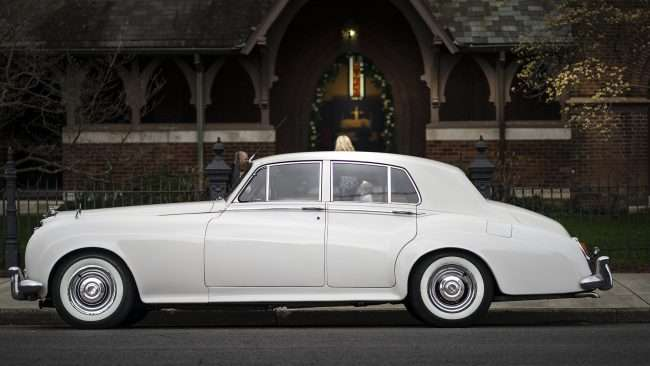 April 12, 2018 - Vintage Bentley from Matchless Transportation Limo Service during Wedding at Grace Episcopal Church in Historic Downtown Paducah Broadway/photonews247.com