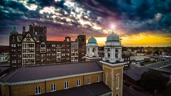 2016 - Paducah Skyline during sunset with St. Francis de Sales Catholic Church and Irvin Cobb Apartments in view by drone photographer MelonManBob in 2016.