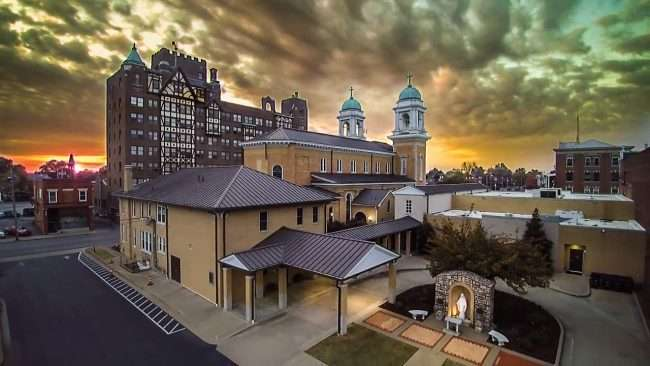 Aerial view in historic downtown Paducah with Saint Francis Church and Irvin Cobb Apartments in view during sunset/2016 Drone Photography by Bob Dwyer