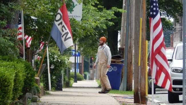 May 28, 2018 - Gentleman walks towards fLags flying on Memorial Day in the Lower Town Art District Neighborhood of Paducah, KY/photonews247.com