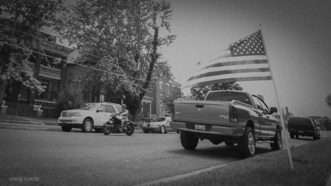 May 28, 2018 - Motorcyclist drives past flag on Memorial Day in the Lower Town Arts District neighborhood of Paducah, KY/photonews247.com