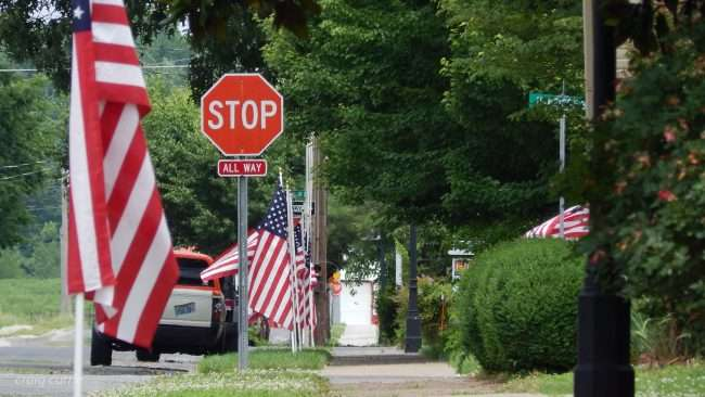 May 28, 2018 - U.S. flags along sidewalk on Memorial Day in the Lower Town Arts District neighborhood of Paducah, KY/photonews247.com