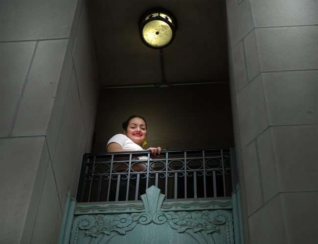 Amanda Casandra fashion designer on balcony at The Last Hotel in St. Louis. credit craig currie