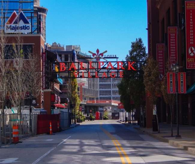 Ballpark Village signage next to One Cardinal Way Apartments Downtown St. Louis