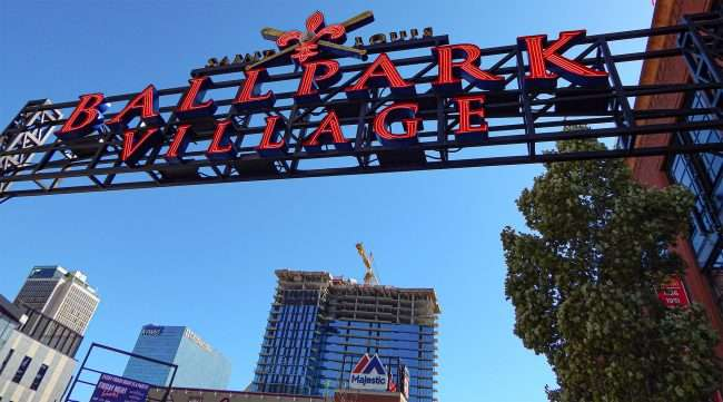 Ballpark Village signage next to One Cardinal Way Apartments Downtown St. Louis MO