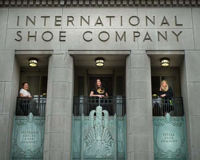 Amanda Casandra, Barbara Boulton and Courtney Tharpe on balcony of The Last Hotel formally the Continental Shoe Company in the Garment District in St. Louis. credit craig currie