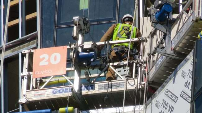 Construction worker on scaffolding at 100 North Kingshighway skyrise building in the Central West End neighborhood in St. Louis, MO.