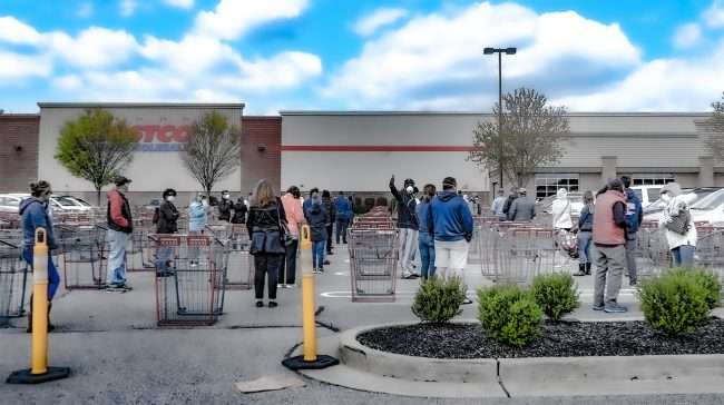 Costco Customers practice Social Distancing Distancing in parking lot while they wait their turn to shop at the Manchester location in St. Louis during Covid-19 lockdown and Stay-at-home orders.