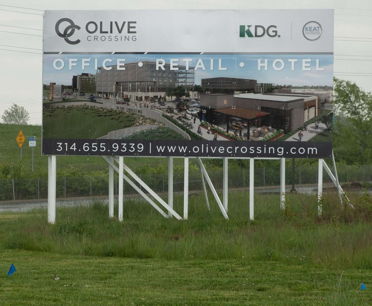 Billboard for Olive Crossing Development by Keat Properties at Olive Blvd and I-70 May 14, 2020.