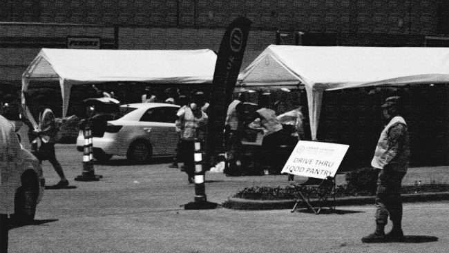 B&W image of Urban League of Metropolitan of St Louis during Drive Through Food Pantry at The Shops at Roberts Village, May 23, 2020.