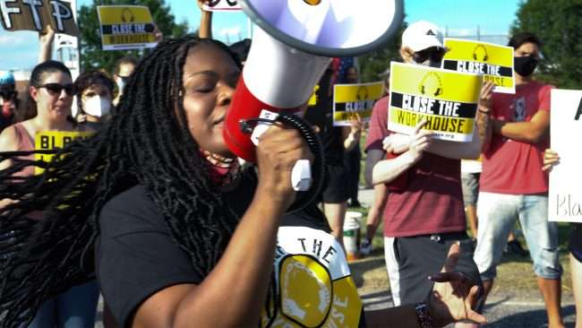 Cori Bush Protesting to close down Workhouse Jail on Hall Street in St. Louis. credit craig currie