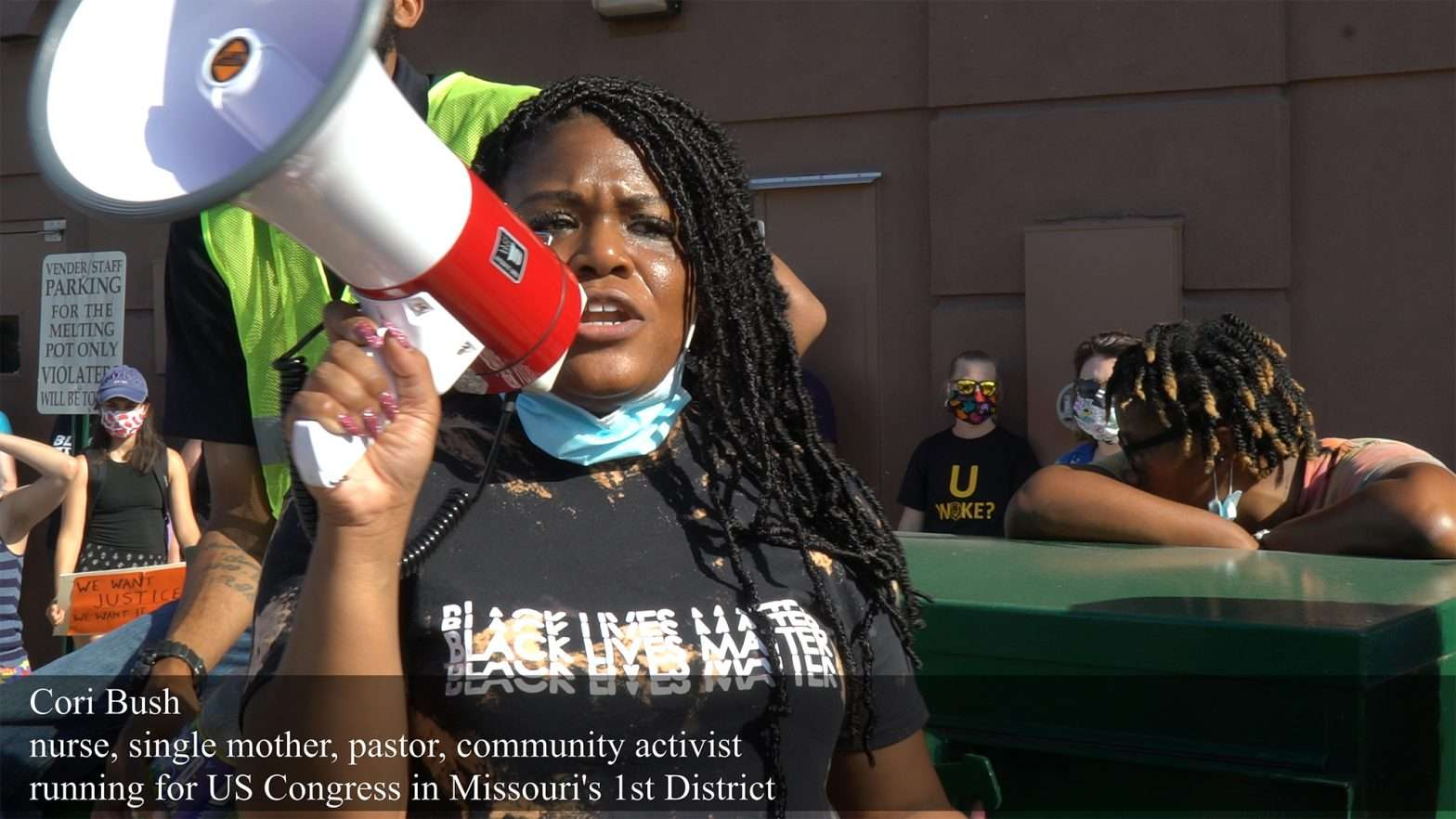 Cori Bush speaks at Delmar Dived Protest known as red-lining in University City. credit craig currie