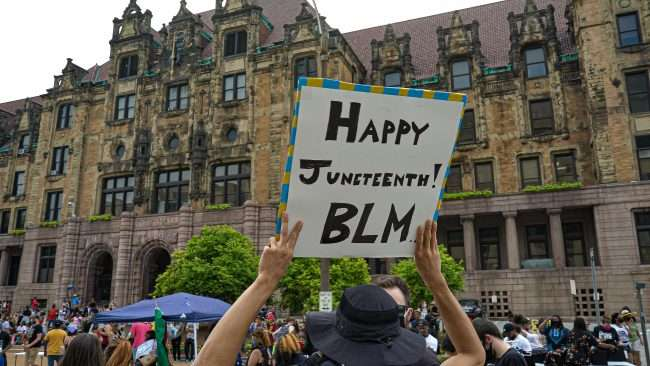 "Sign that reads ""Happy Juneteenth BLM"" at St Louis City Hall. credit craig currie"
