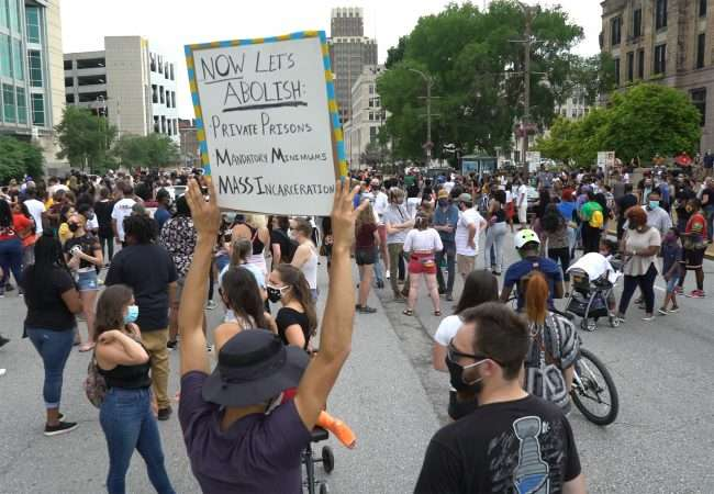 """Juneteenth: Sign that reads """"Abolish Mass Incarceration"""" at St Louis City Hall. credit craig currie"""