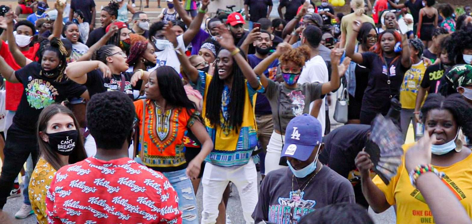 Juneteenth: hundreds dancing having fun on Tucker Blvd. in front of St. Louis City Hall. credit craig currie