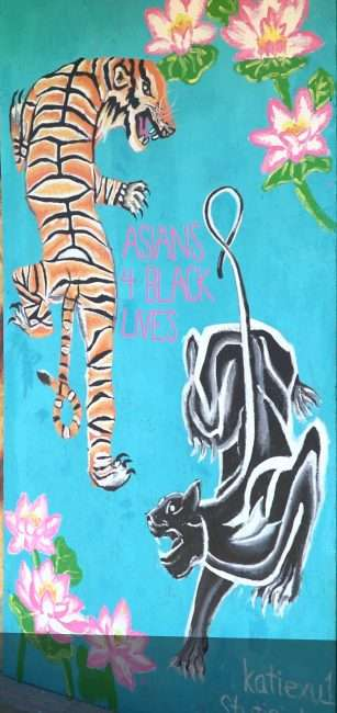 Painting depicting Asians For Black Lives with Tiger and Panther teaming up for cause along the Delmar Loop University City. credit craig currie