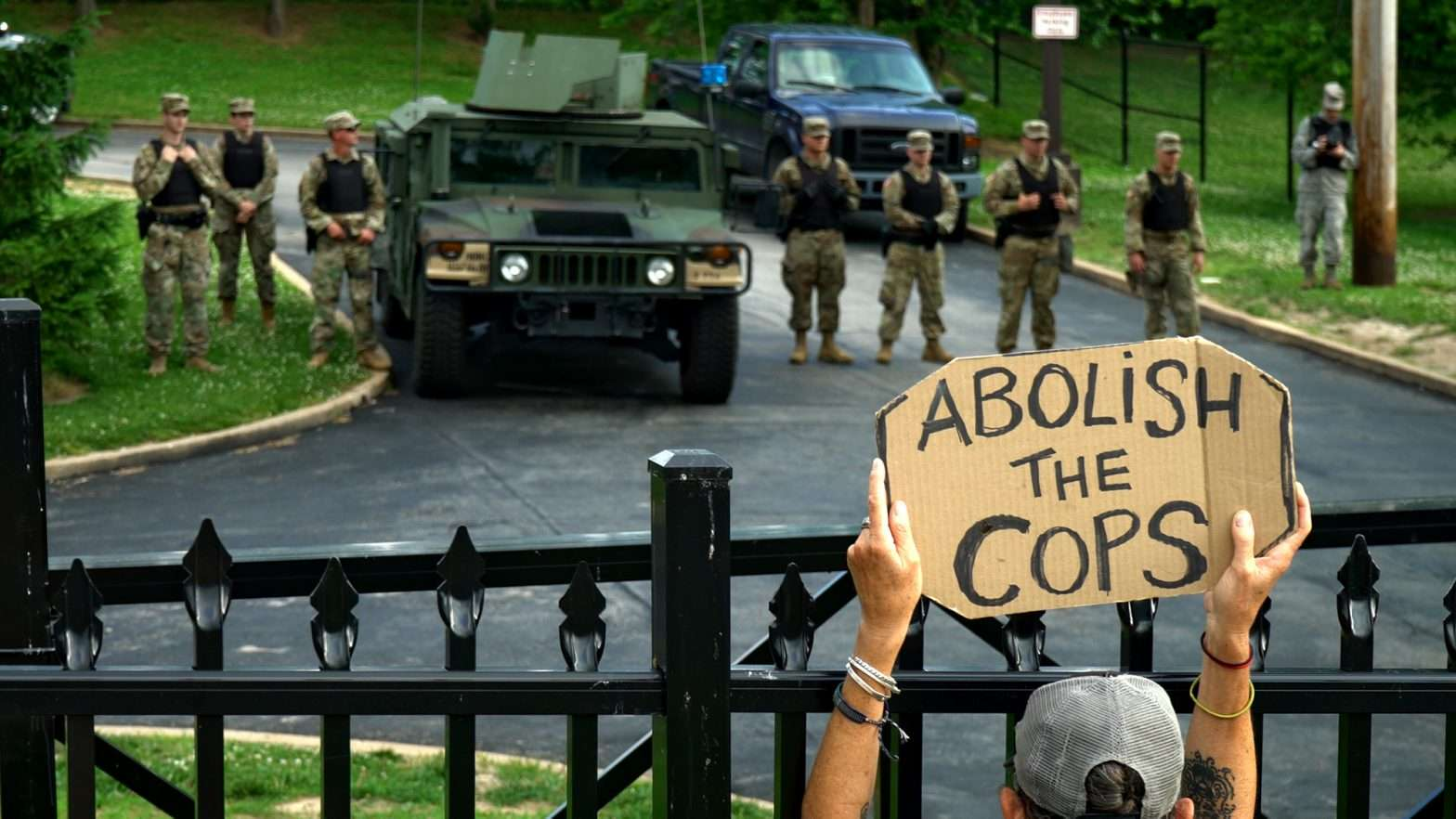 Protesters are met with MP National Guard at Florissant Police Department in St. Louis County. credit craig currie