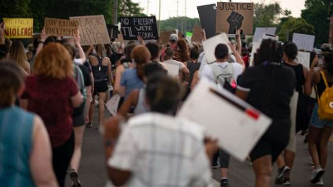 Protesters march holding black lives matter signs St Charles, MO. Craig Currie | PhotoNews247.com