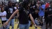 Woman solo dancing is circle at Juneteenth celebration in Downtown St. Louis. credit craig curie