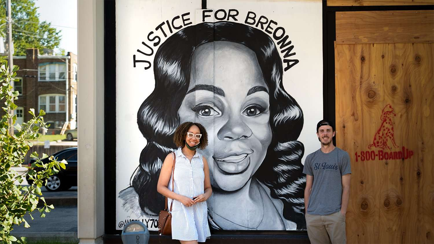 Artist Ben Angelly standing in front of his painting of Breonna Taylor with fan on Delmar Blvd. in the Delmar Loop area in University City. credit craig currie